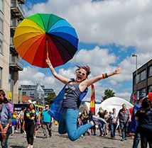 Indeedian at the Dublin Pride Parade with a rainbow umbrella
